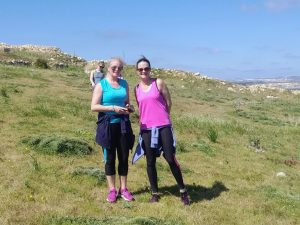 Two women on a green field