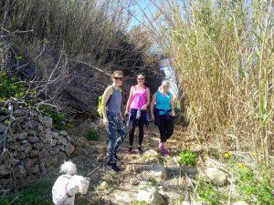 Girls walking through high grass