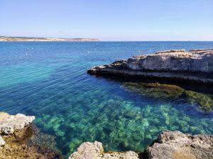 Beautiful green sea water with rocks